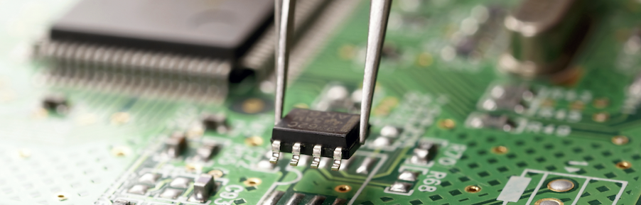 technician servicing a circuit board