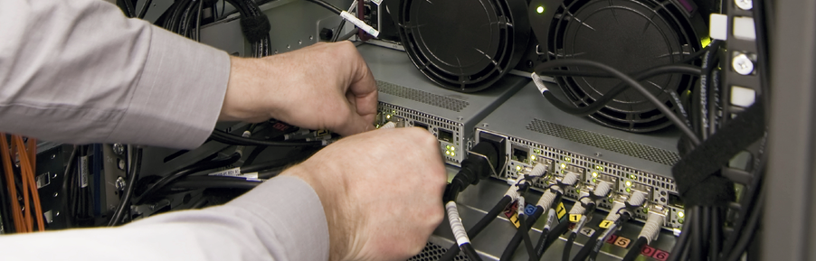 technician servicing an onsite rack of equipment