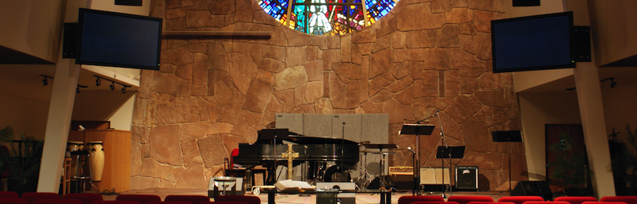 church with stained glass and two plasma displays